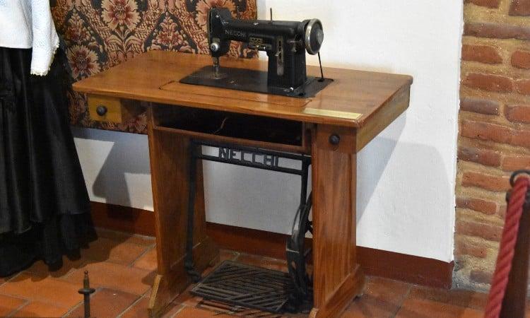Necchi vintage sewing machine in cabinet