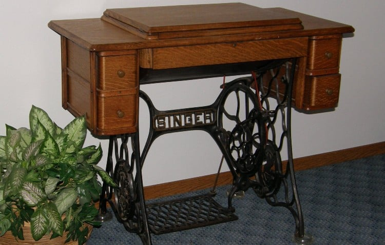 Sewing machine in wood cabinet